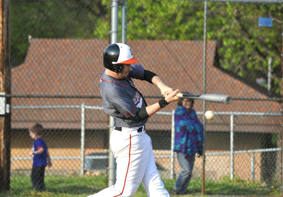 Edwardsville's Maverick McSparin swings at a pitch in the seventh inning of Tuesday's Southwestern Conference game at Collinsville. Later in the same at-bat, McSparin hit a two-run, game-winning homer.