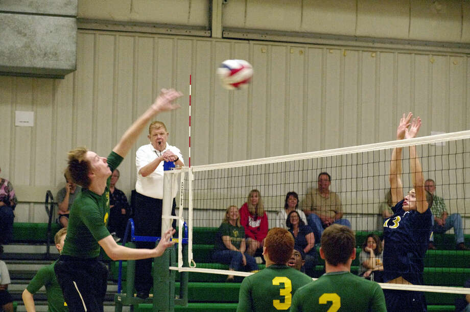 Metro-East Lutheran sophomore AJ Risavy spikes the ball during a match against Althoff in Saturday's round robin at MELHS. Photo: GRETCHEN ENGELBRECHT For The Intelligencer