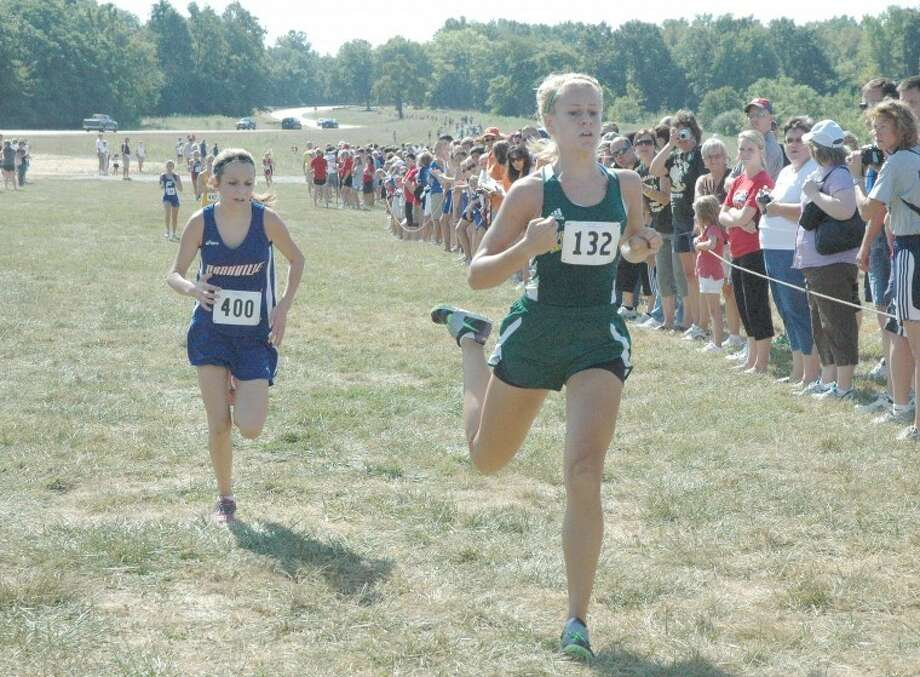 Metro-East Lutheran's Jessica Jump, front, crosses the finish line at the first ever Metro-East Debut Invitational on Saturday at SIUE. Jump finished 23rd overall to lead the girls' team.