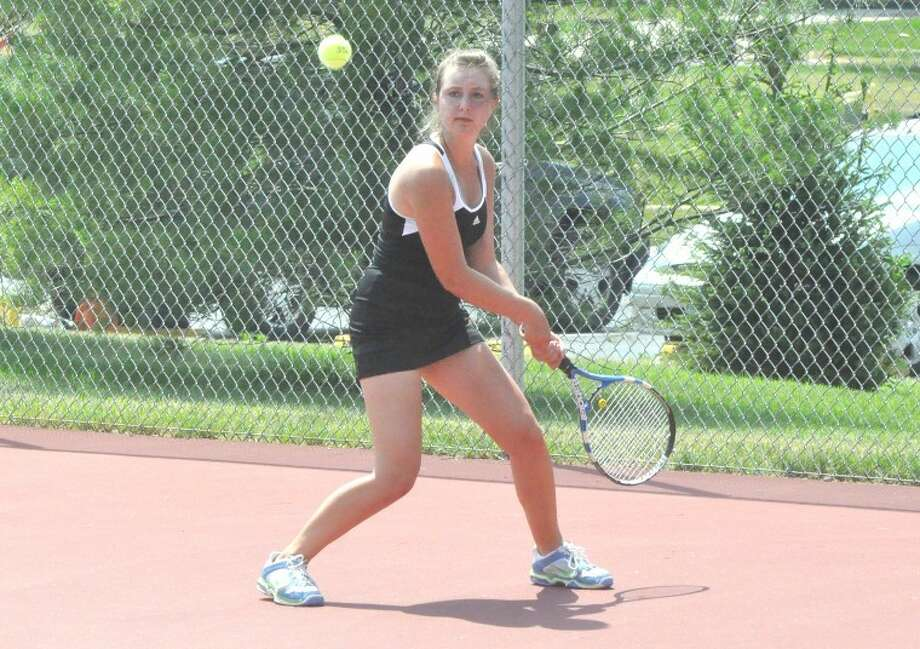 Paige Bequette, a soon-to-be senior for the Edwardsville Tiger girls' tennis team, hits a back hand return during action in the Edwardsville Open Saturday at the EHS Tennis Center.