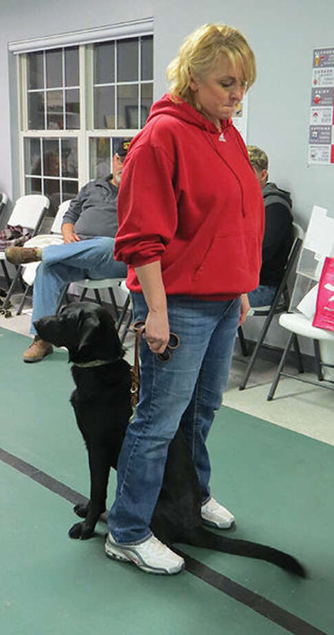 Heather Chapman, a volunteer with Got Your Six Support Dogs, trains a dog to cover, or watch her back. Photo: Carol Arnett/Intelligencer