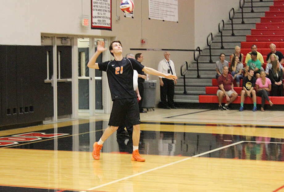 Edwardsville's Bryce Wunderlich completes his serve during Tuesday's match against Plainfield Central at Bolingbrook.   Photo: Evan Meyers