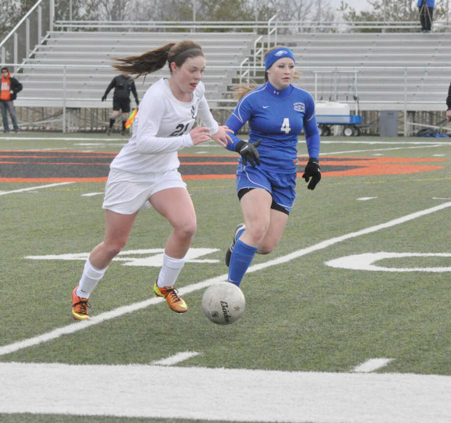 Edwardsville's Allison Pritchard dribbles the ball down the field with Columbia's Lauren Tolan applying pressure.