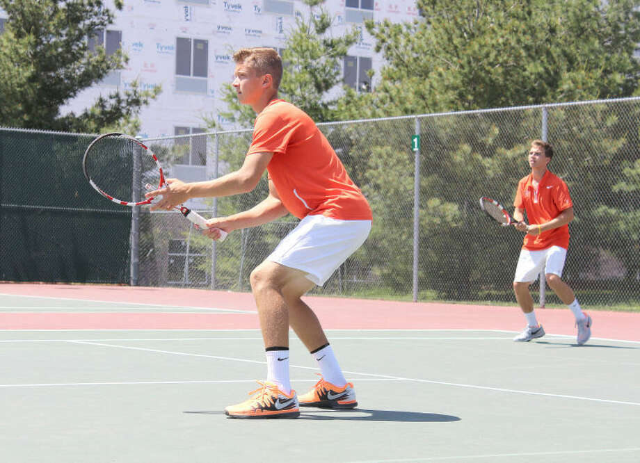 Edwardsville's Jack Desse, left, and Logan Ware, right, compete during the Edwardsville Sectional earlier in the season. At state from Thursday through Saturday, Desse and Ware went 4-2 as a doubles team.