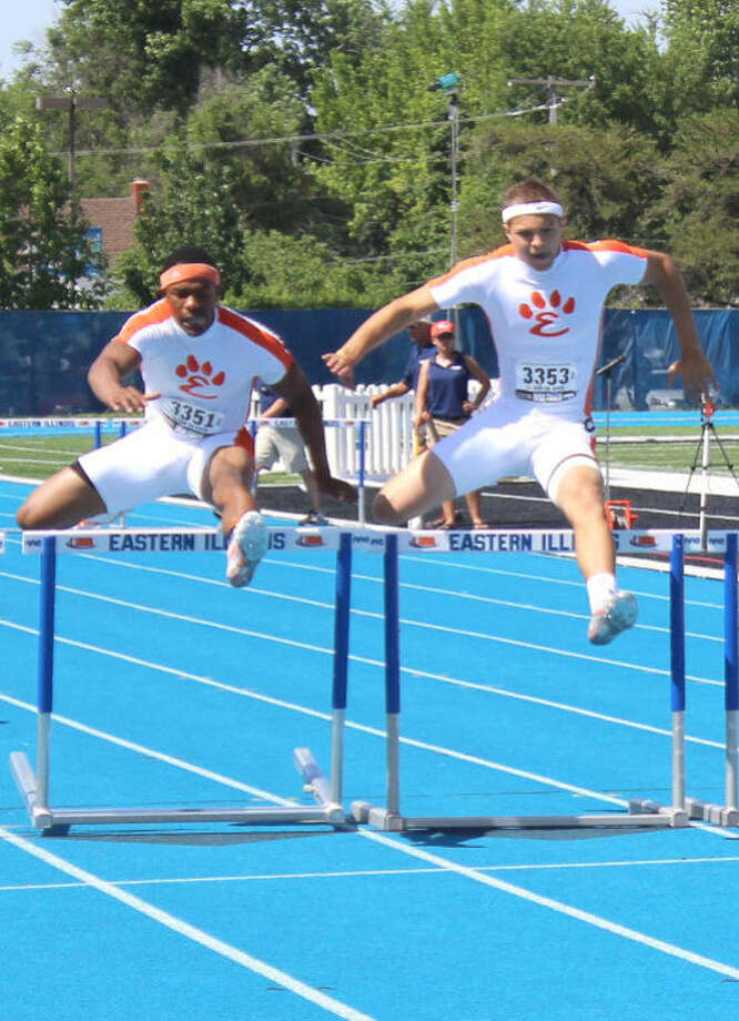 Edwardsville's Craig James, left, and Isaiah Michl, right, compete in the 300-meter hurdles Saturday at the Class 3A state meet.