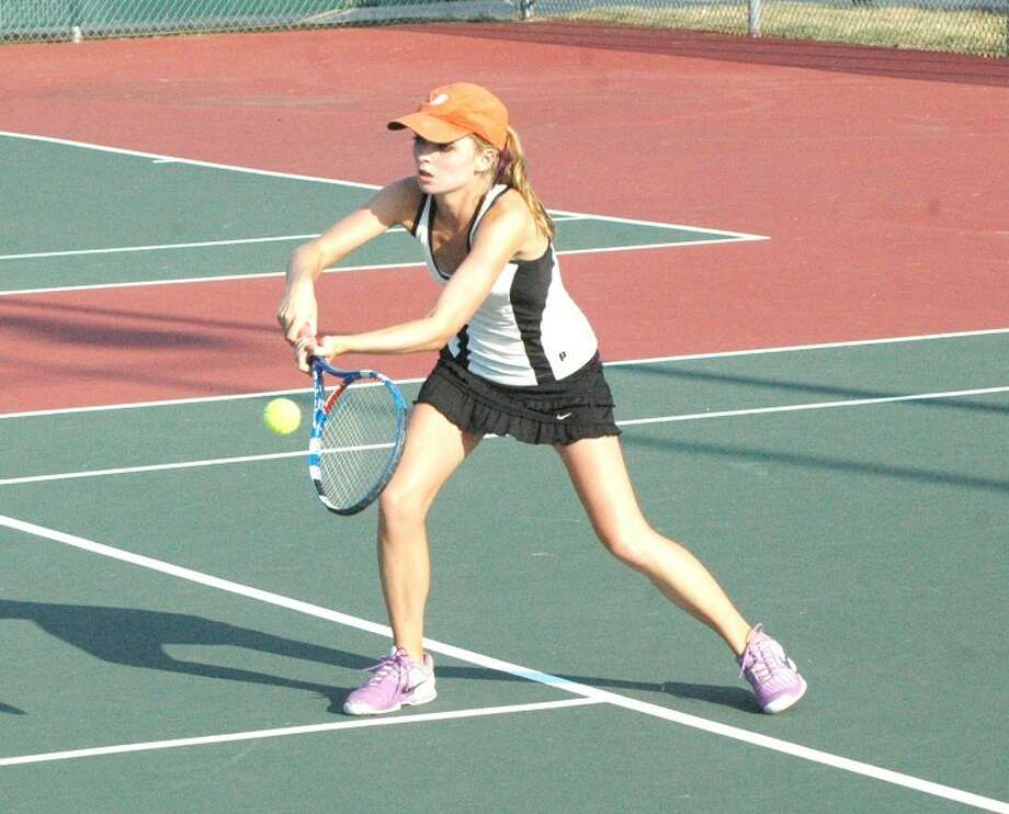 Edwardsville Tiger Morgan McGinnis hits a return Friday at the EHS Tennis Center during her No. 1 singles match against Incarnate Word Academy's Kaitlyn George. McGinnis won 6-1 and 6-0.