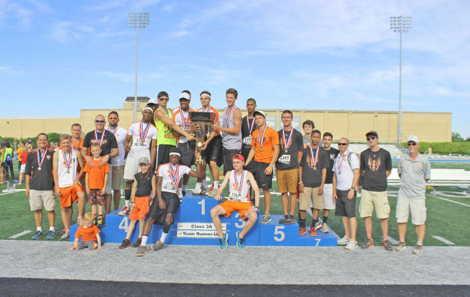 The Edwardsville Tigers pose with the team trophy Saturday after tying three-time defending champ Roselle Lake Park for second place at the Class 3A state meet at O'Brien Stadium in Charleston.