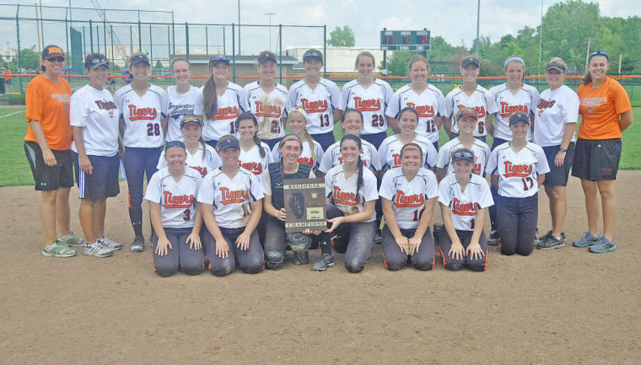 The Edwardsville softball team poses with the Class 4A Edwardsville Regional championship plaque after defeating Alton 11-2 on Saturday at the District 7 Sports Complex. EHS plays Belleville East in the O'Fallon Sectional semis at 4:30 p.m. today.