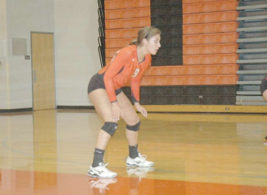 Edwardsville Tiger Sam Epenesa prepares to defend an Eureka serve during the Tiger Classic on Friday at Lucco-Jackson Gymnasium. EHS went 2-0 on Friday.