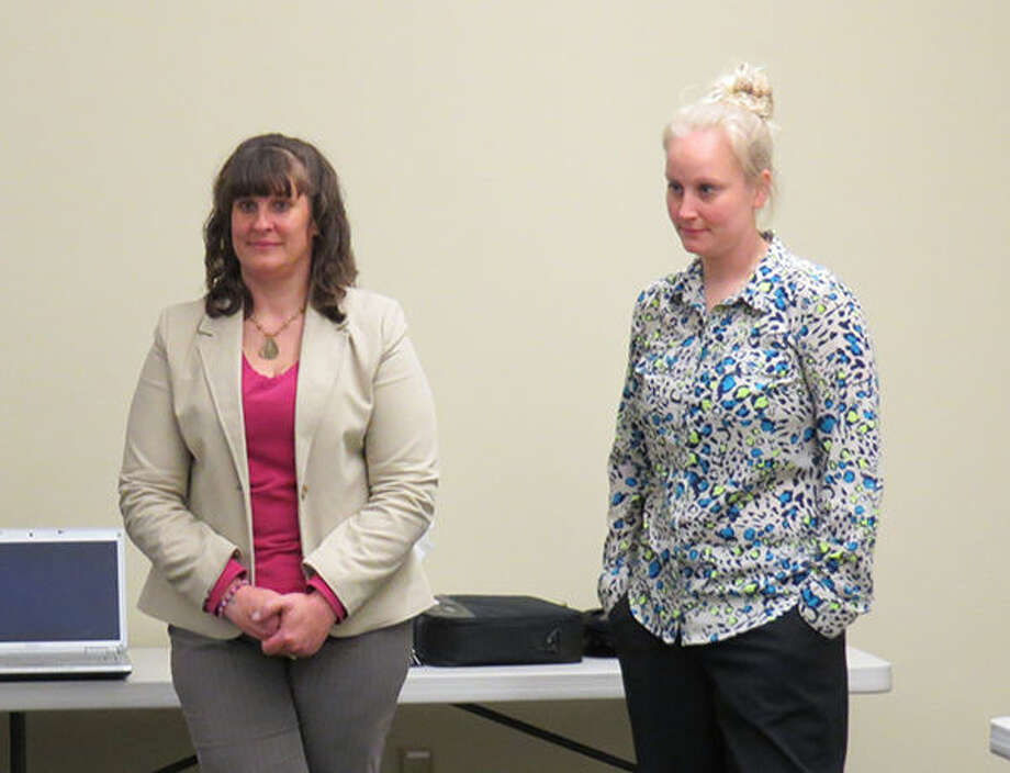 Suzanne Phegley from FCB Bank and Kim Singer from the IRS, two presenters at the Fraud Prevention Seminar in Glen Carbon, listen as another speaker discusses scams and frauds.