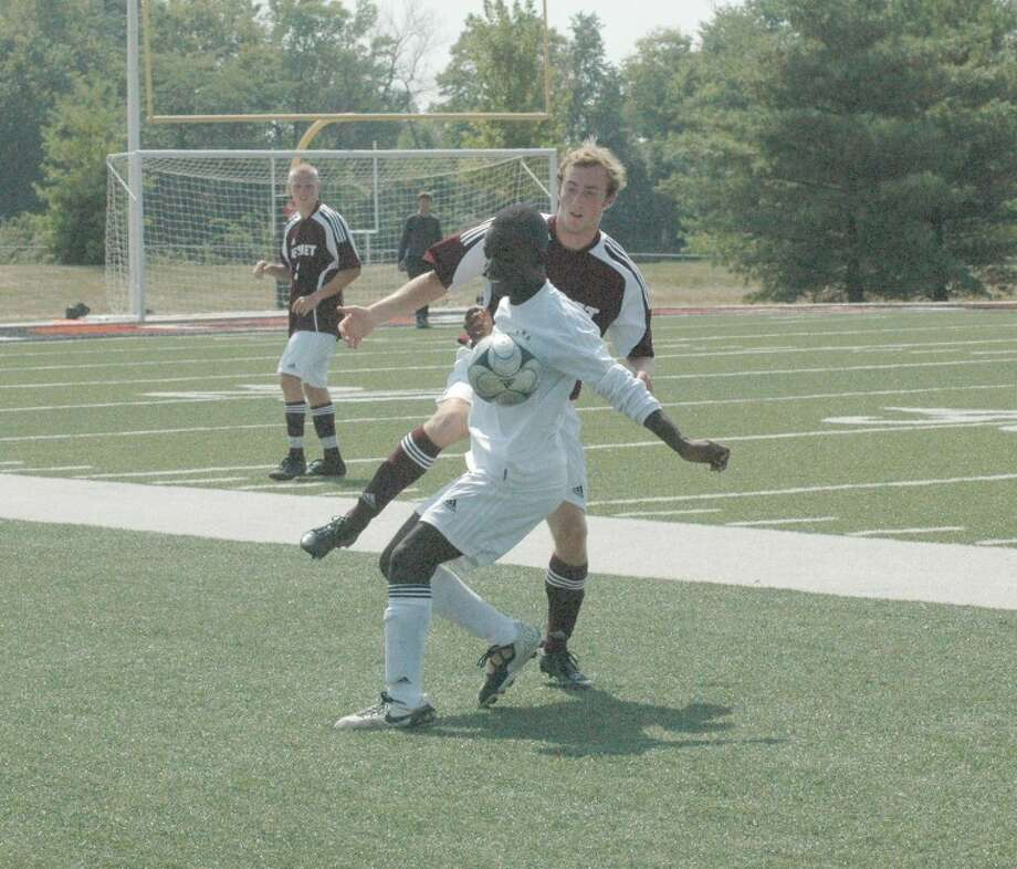 Tiger Papa Blankson, front, battles a DeSmet defender for a loose ball on Saturday at the District 7 Sports Complex.