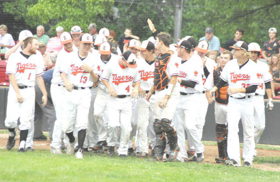 The Tigers celebrate as a team at home plate after Aaron Jackson cracked a three-run homer in the fifth inning against Belleville West on Wednesday in Granite City. EHS will face Moline at 11 a.m. today in the Class 4A Illinois Wesleyan Sectional finals in Bloomington. Photo: Evan Meyers