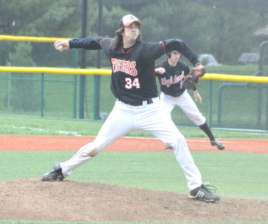 Edwardsville's Bryce Cantrall works in relief in Game 1 of a doubleheader with Highland on Saturday at the JV Turf Field, picking up the win.