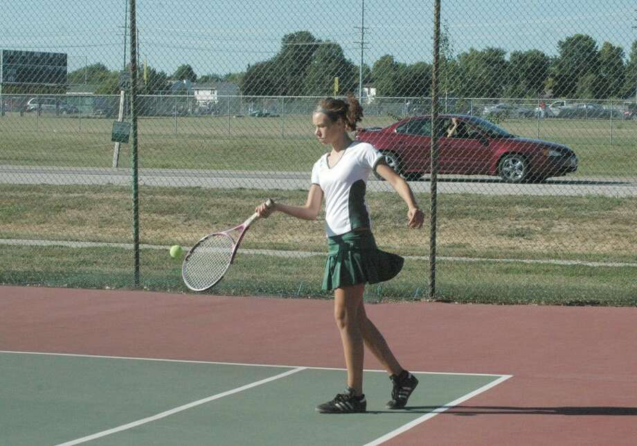 MELHS's Abby Edwards returns a serve during No. 1 singles action against East Alton-Wood River on Tuesday.