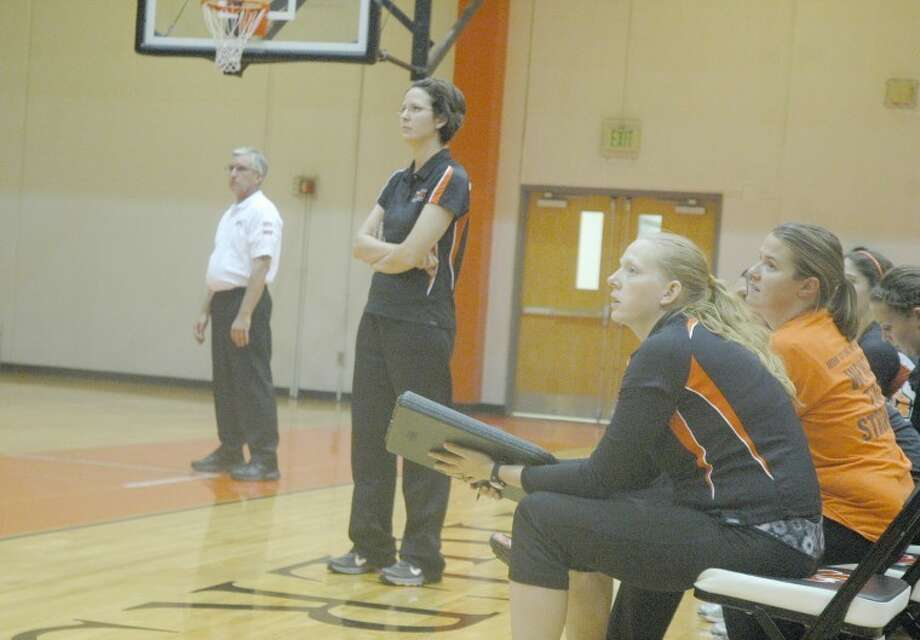 Edwardsville girls' volleyball head coach, standing center, and her coaching staff watch action during the championship game of the Tiger Classic against Mater Dei on Saturday.