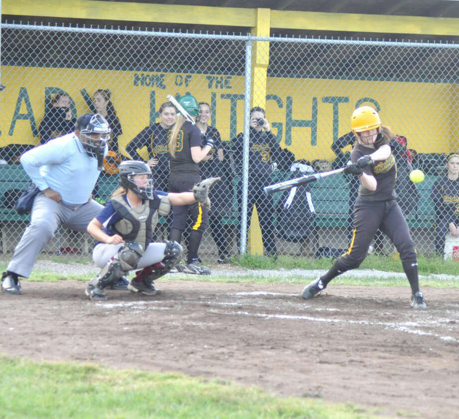 Metro-East Lutheran's Abby McMahon hits a sacrifice fly in the fourth inning Monday vs. Gibault at Sigmund Bohnet Field.