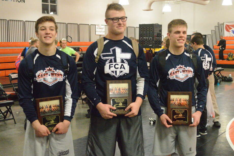 Edwardsville wrestlers James Watters, left, Bobby Burnside, center, and Chris Prosser pose with their plaques from the East-West Wrestling All-Star meet.