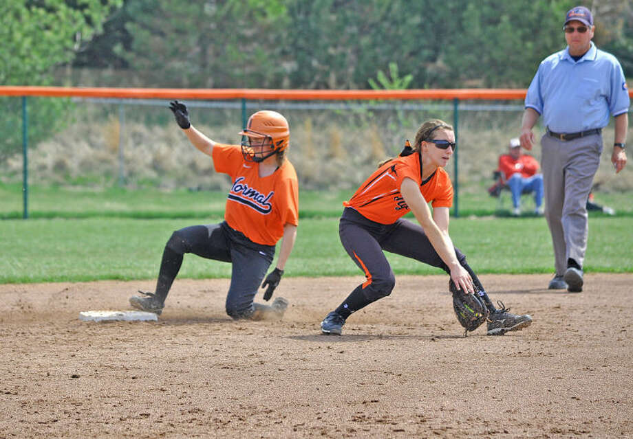 Edwardsville's Ari Arnold catches a throw from Anna Walschleger, as Normal Community's Nikki Lewis slides safely into second base with a stolen base on April 12.