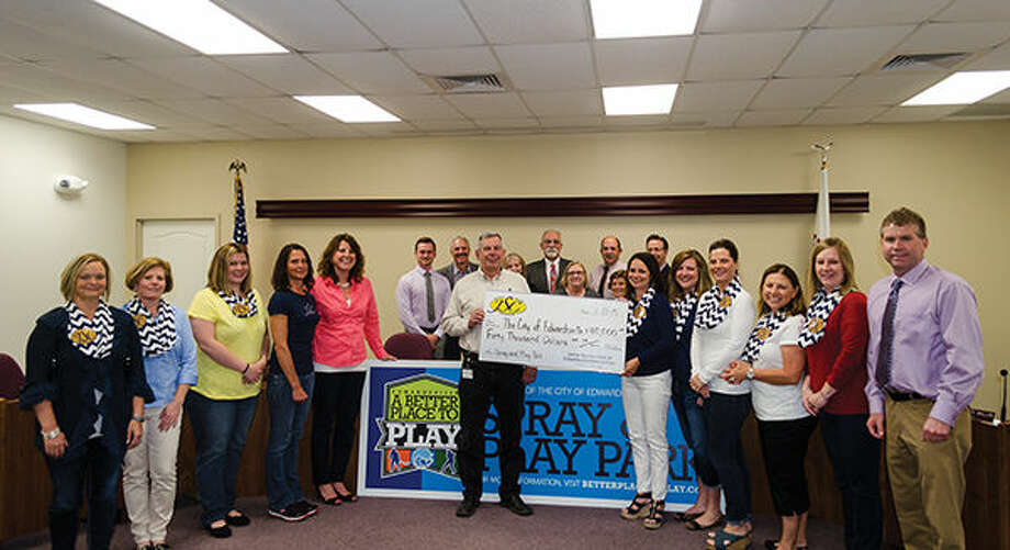 Members of the Junior Service Club of Edwardsville/Glen Carbon present a check for $40,000 to the city of Edwardsville for the Spray and Play Park.