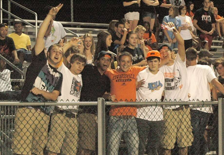 Edwardsville Tiger football fans celebrate during the team's 51-6 victory over Chicago Bogan in the 2011 home opener at the District 7 Sports Complex on Saturday.