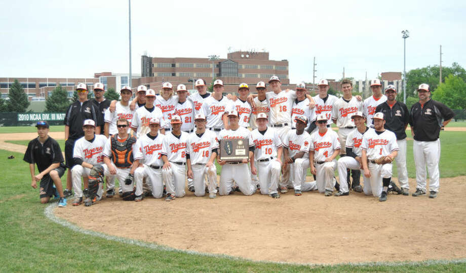 The Edwardsville Tigers pose with the Class 4A Illinois Wesleyan Sectional plaque after defeating Moline 10-1 on Saturday in the sectional finals.