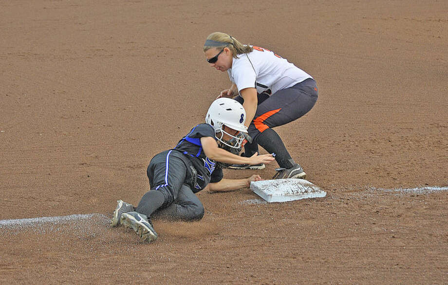 Edwardsville third baseman Katelyn Bobrowski tags out the Lincoln-Way East runner at third in the first inning.