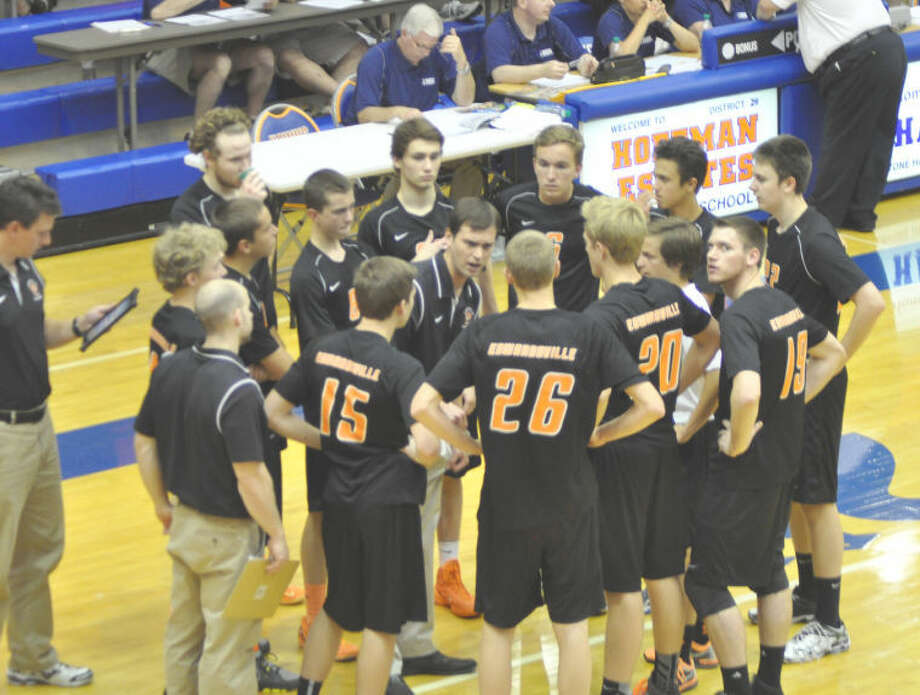 Edwardsville boys' volleyball coach Andy Bersett talks to his team during Friday's state quarterfinal match against Lincoln-Way East at Hoffman Estates.