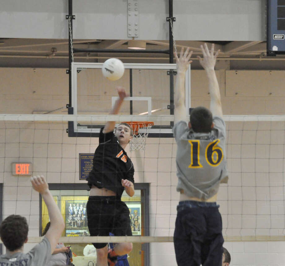 Edwardsville's Nathan Woolverton attempts to place a kill attempt past an O'Fallon blocker during the semifinals of the Southwestern Illinois Boys' Volleyball Varsity Tournament in O'Fallon.