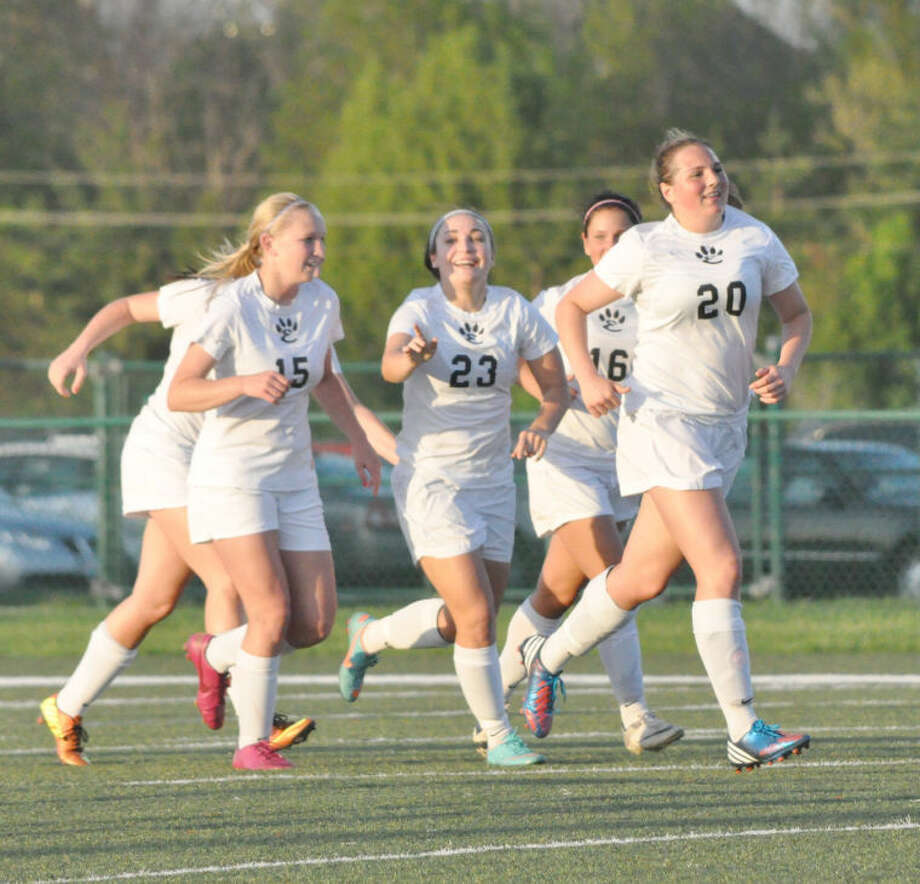 Edwardsville defender Rachel Wiesehan (No. 23) celebrates her goal against the Alton Redbirds in the 30th minute on Tuesday at the District 7 Sports Complex.