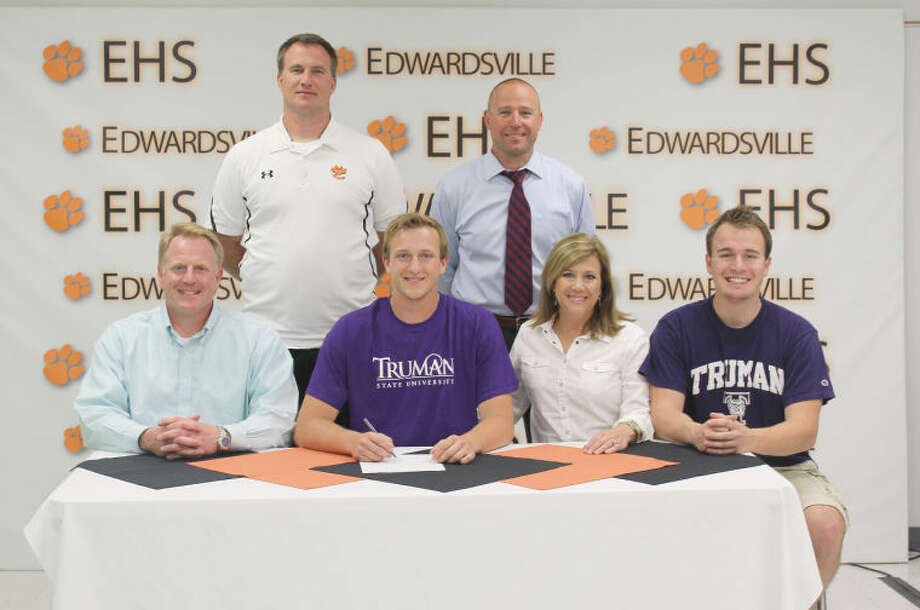 As his parents Greg and Jean and brother Kellen look on, Edwardsville's Kavan Weiss signs a letter of intent to compete in track and field at Truman State University. In the back row are EHS assistant coach Matt Martin (left) and head coach Chad Lakatos.