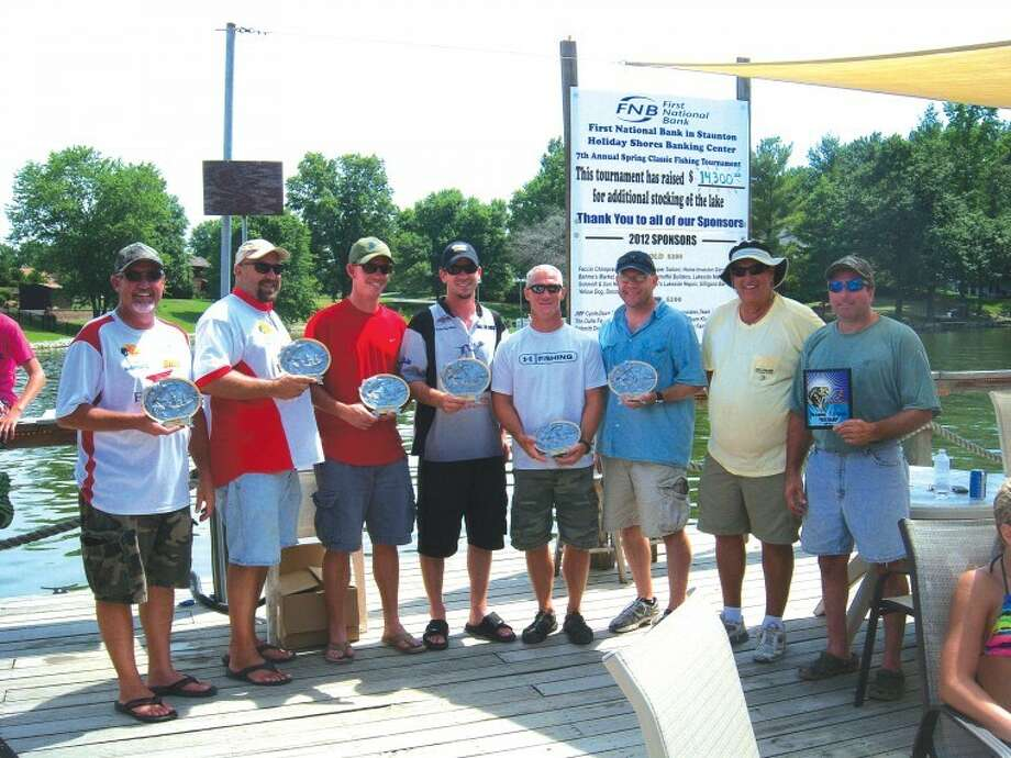 The top winners ofthe 7th Annual Spring Classic Fishing Tournament conducted on June 23 and 24 on Holiday Lake stand with their trophies. From left are: second place finishers: Paul Worthey andKevin Suttles, first place finishers: Kyle David and Andy Paschedag; third place finishers: Eric Roberson and Jeff Hudson and big bass winners: Rich Harrison and Michael Scheffel.More than $14,000 has been raised through the tournamentfor restockingHoliday Lake.