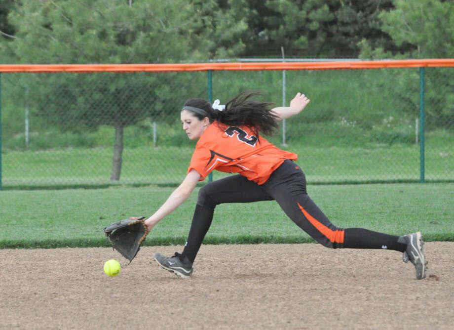 Edwardsville second baseman Olivia Nicholls reaches for a ground ball during the first inning.