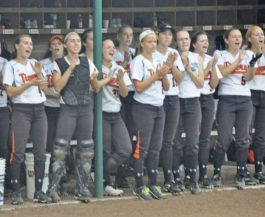 The Edwardsville softball team applauds on teammates during Monday's game against Lincoln-Way East in the Class 4A Illinois State University Super-Sectional game.