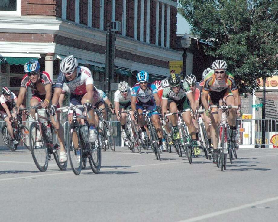 Riders in the 2011 Edwardsville Rotary Criterium make the turn onto Vandalia from Main Street. Photo: Craig Thomas/Intelligencer