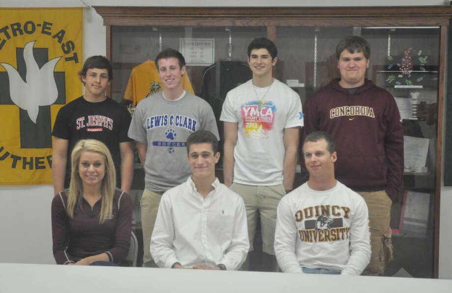 Metro-East Lutheran High School had seven of its student-athletes sign to play their respective sports in college. Pictured left, seated from left to right are: Jessica Jump (SIU Carbondale, track and field and cross country), Jon Babcock (Mid-America Nazarene University, soccer) and Chris Barry (Quincy University, baseball). Standing from left to right are: Ryan Keck (St. Joseph's College, baseball), Evan Winenger (Lewis and Clark, soccer), Christian Aragona (Western Kentucky, swimming) and Ethan Borchers (Concordia-Chicago, track and field). Individual stories on each recruit will run at later dates.