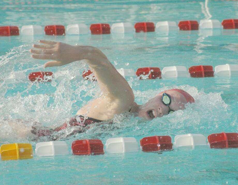 Water Works' Kristin Schoenecker competes in the girls' 15-18 100 meter freestyle against the Granite City Paddlers on Thursday at Water Works Swim Club.