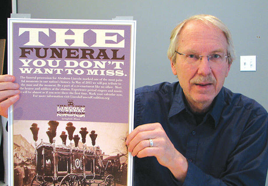 Inlandesign's John Celuch holds the poster he designed for the Lincoln Funeral Re-enactment, which is scheduled Saturday and Sunday in Springfield. Photo: Carol Arnett/Intelligencer