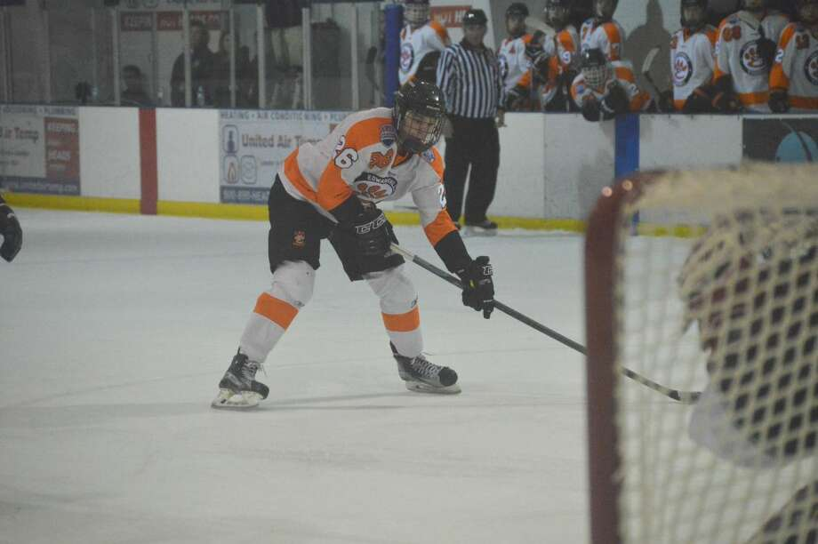 Edwardsville's Logan Bielicke prepares to shoot after breaking into the zone in the second period.
