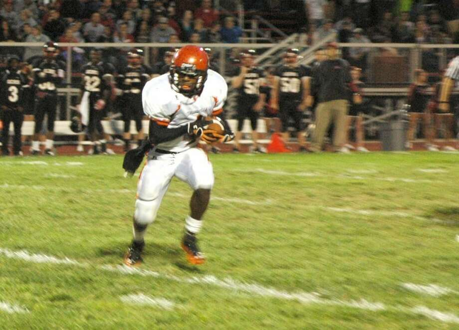 Edwardsville Tiger running back Cameron James darts for the sideline on his 29-yard touchdown run in the first quarter Friday in Granite City. The Warriors beat the Tigers 42-21.