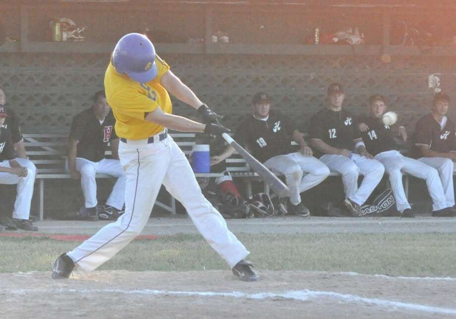 Edwardsville American Legion Post 199's Jake Hanks rips an RBI-single in the first inning on Sunday at Glik Park in Highland against Highland Post 439.
