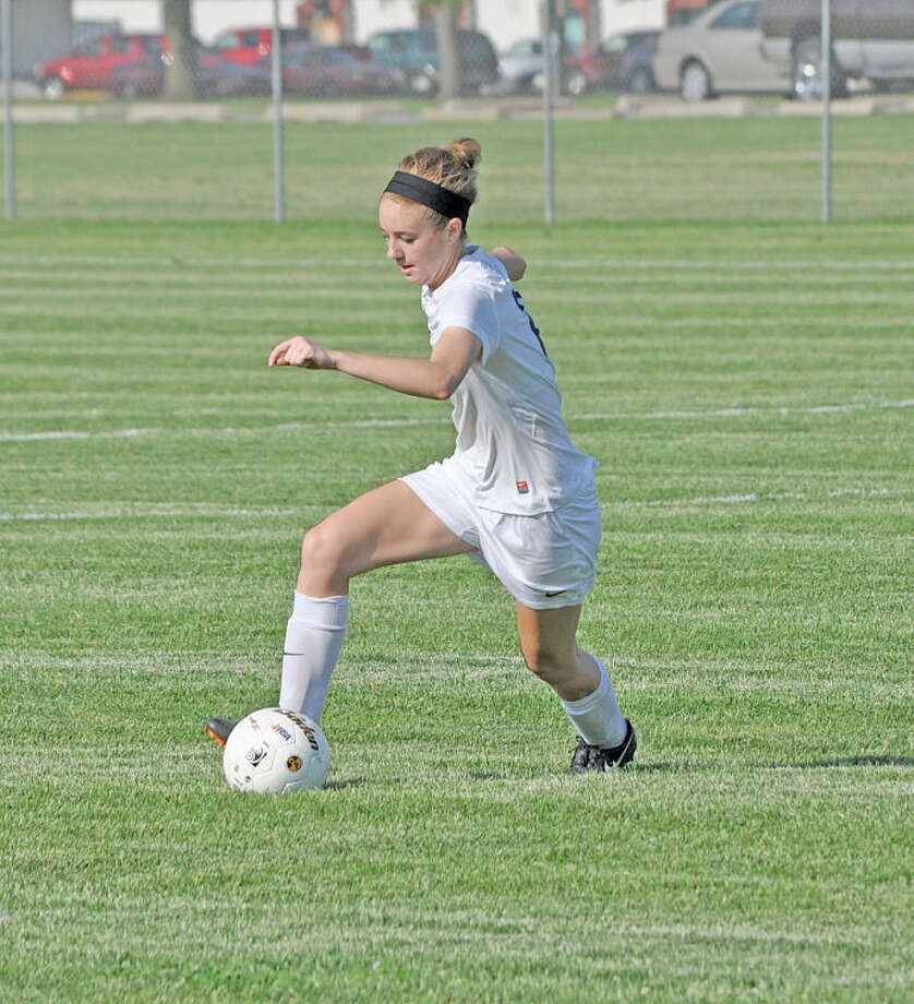 Edwardsville senior Lilly Cobb turns up the field during the 2014 season. Cobb was named MVP for girls' soccer.