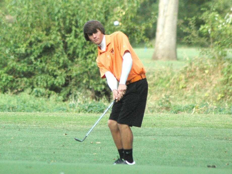 Edwardsville Tiger Connor Bradley chips onto the green on Thursday at Oak Brook Golf Club during a non-conference dual with Belleville Althoff. EHS won the dual by two strokes to remain undefeated in duals in 2011.