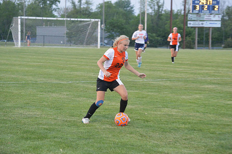 Edwardsville sophomore Taylor Hansen looks to pass late in the second half of Wednesday's game at Rochester.