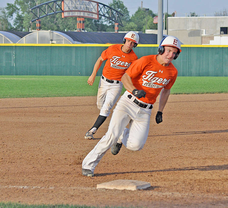 Edwardsville base runners Cole Cimarolli, front, and Mitchell Krebs race around third base on Jordan Hovey's triple in the fourth inning against the St. Louis Pirates at Tom Pile Field.