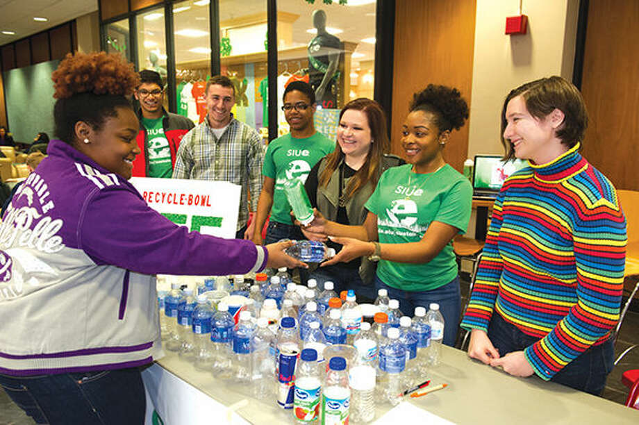 Jayla Cole, a freshman social work major, turns in an empty water bottle for an SIUE reusable one. Students shown from left: Bilal Aziz, sophomore electrical engineering major; Anthony Kindle, freshman mechanical engineering major; Allen Adams, freshman electrical engineering major; Kealy Nolfo, freshman education major; Sydney Jackson, junior criminal justice major and Rebekah Bartholomew, first year pharmacy student. Photo: For The Intelligencer