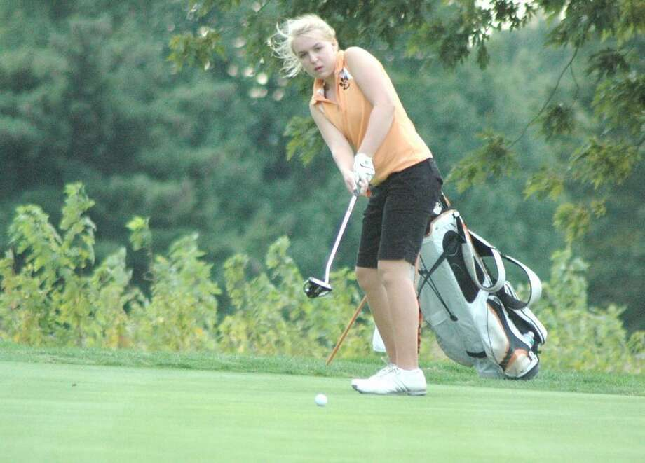 Edwardsville's Austin Gordon watches one of her putts during a dual with the O'Fallon Panthers at Tamarack Country Club in Shiloh on Monday.