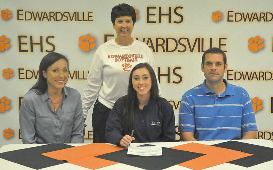Edwardsville's Anna Walschleger will continue her softball career at Lincoln Land Community College in Springfield next year. Seated from left to right are: Rachel Walschleger, mother, Anna Walschleger and John Huber, father. Standing is EHS softball coach Lori Blade.