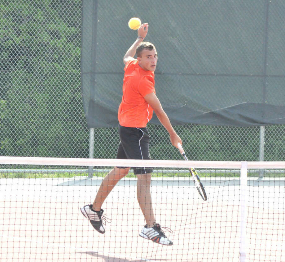 Edwardsville Tiger Zach Bryant smacks a return on Friday at Alton High School during singles action of the Alton Sectional. Bryant, a No. 5 seed in the tournament, defeated Alton's Allan Bower 6-3 and 6-1 in the third round to qualify for state. All four EHS entries advanced to state.