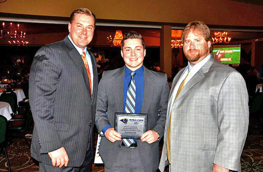 Edwardsville assistant football coaches Jason Steward (left) and Kelsey Pickering (right) join former EHS running back Sam Mulford when Mulford received an award at the Rams Golden Horn Elite Football Award Banquet after the 2012 season. Steward died Sunday at age 37.