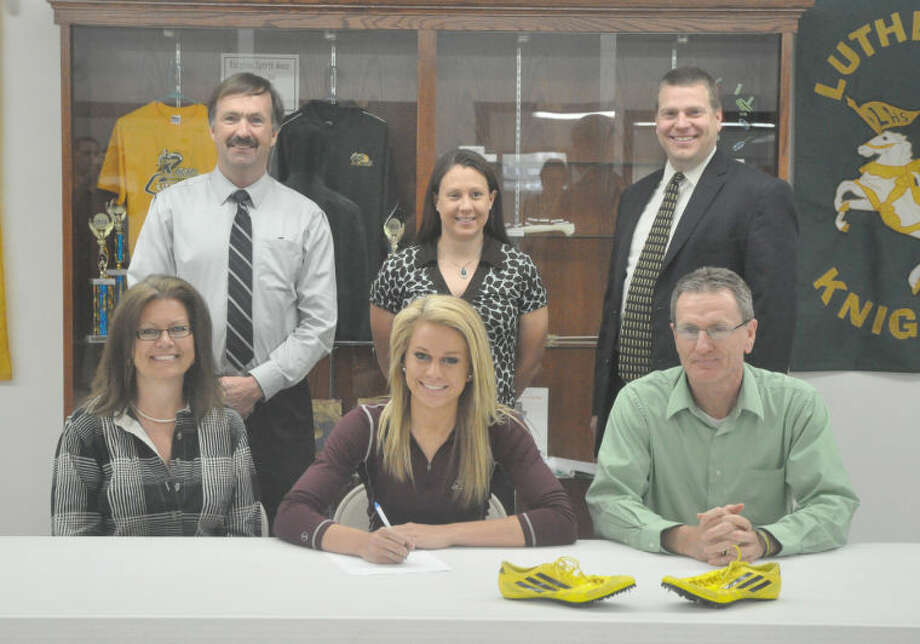 Metro-East Lutheran senior Jessica Jump recently signed with SIU Carbondale to compete in track and field and cross country. Pictured above, seated from left to right are: Susan Jump, mother, Jessica Jump and Jim Jump, father. Standing from left to right are: MELHS athletic director, cross country and track and field coach Dave Redden, MELHS assistant coach Ruth Thompson and MELHS principal Curtis Wudtke.